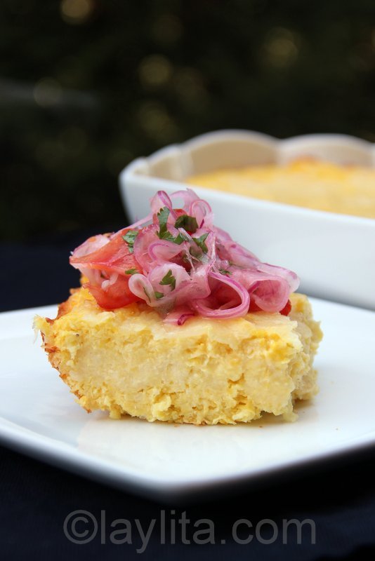 Pastel de choclo or pastel de humita con curtido de tomate y cebolla