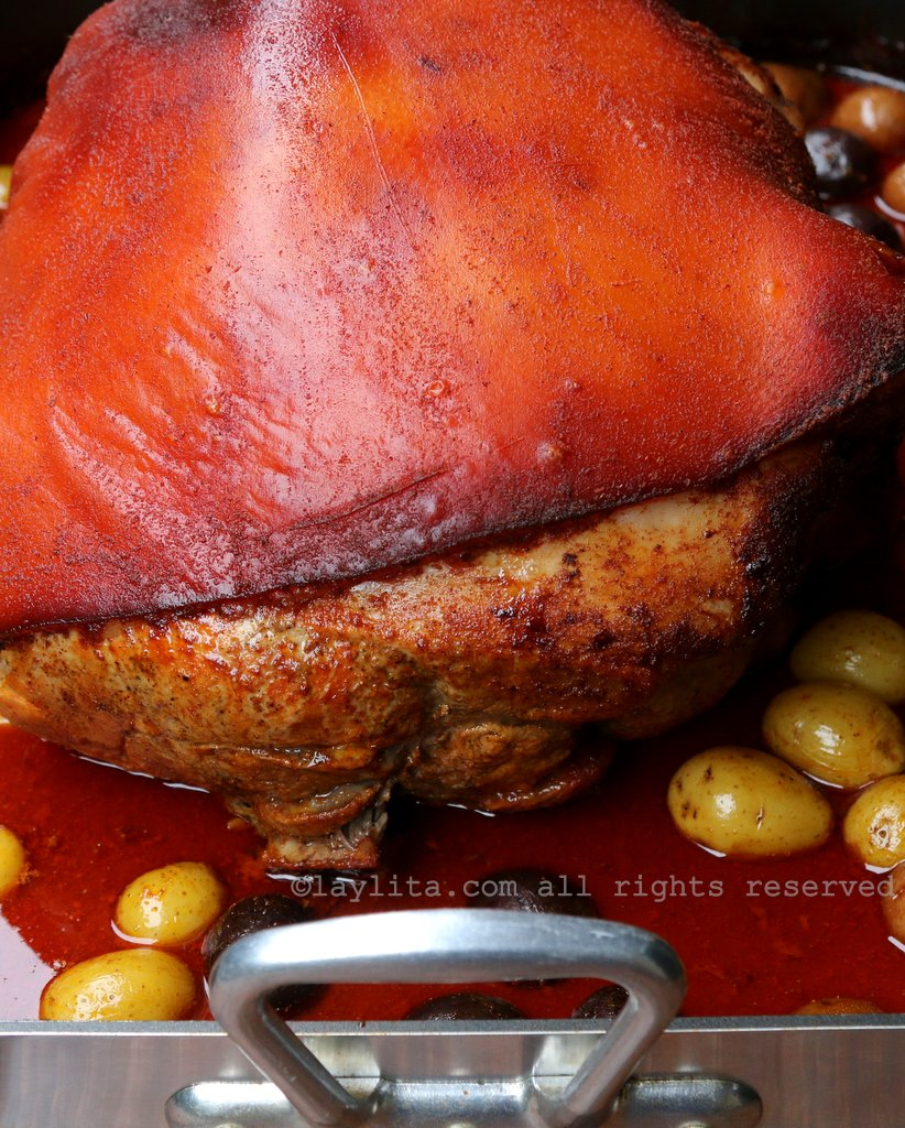 Ecuadorian hornado or roasted pork leg with beer and achiote