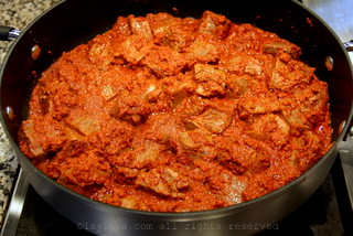 Meat cooking in achiote sauce