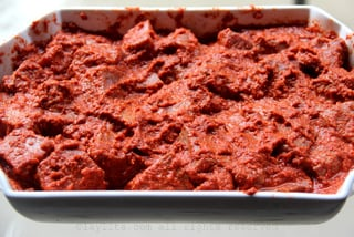 Meat marinating in a mix of garlic, onion, achiote and cumin