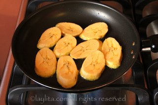 Place the plantain slices in a hot frying pan