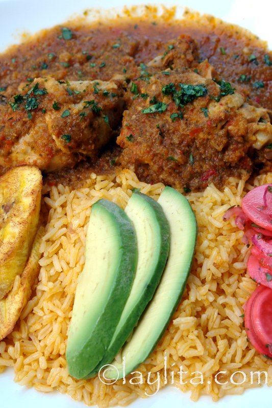 Chicken stew cooked in beer with achiote rice, plantains and avocado