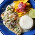 Griled fish with seafood in a garlic white wine sauce