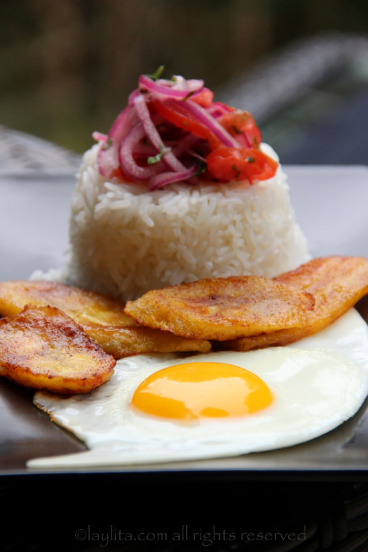 Rice with fried egg, ripe plantains, and tomato onion curtido