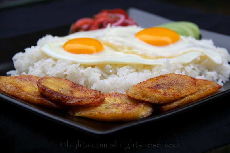 Rice with eggs, plantains, avocado and curtido