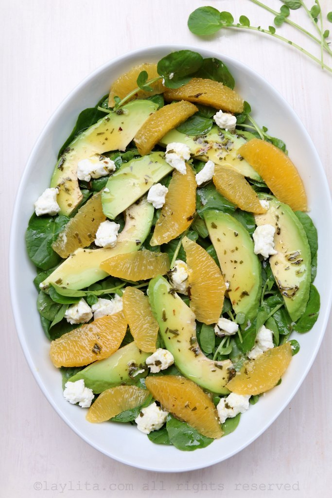 Salad with avocado, orange, goat cheese, and watercress