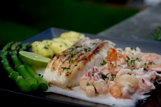 Grilled cod in seafood sauce