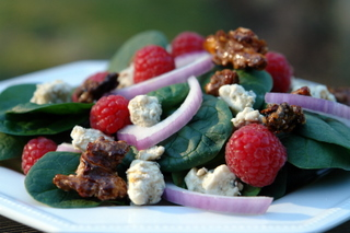 Spinach raspberry salad with gorgonzola and honey roasted walnuts