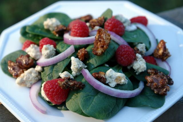 Spinach raspberry salad with gorgonzola and honey roasted walnuts