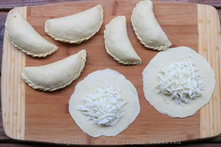Place the cheese mix on the center of each empanada