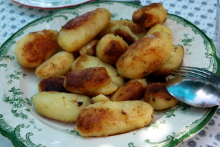 Whole potatoes browned in butter