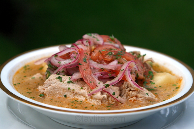 Encebollado de atun or fish soup with tomato onion salsa