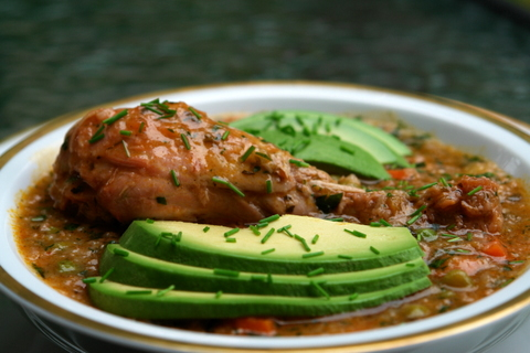 Chicken rice soup or aguado with avocado slices