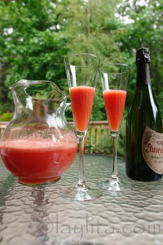 Preparing watermelon mimosas for brunch