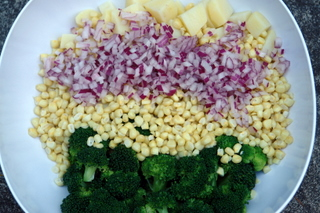 Corn, broccoli and potato salad preparation