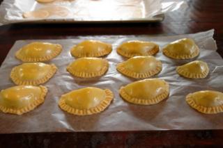 Making homemade empanadas