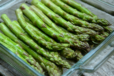 Rub the asparagus with oil and salt