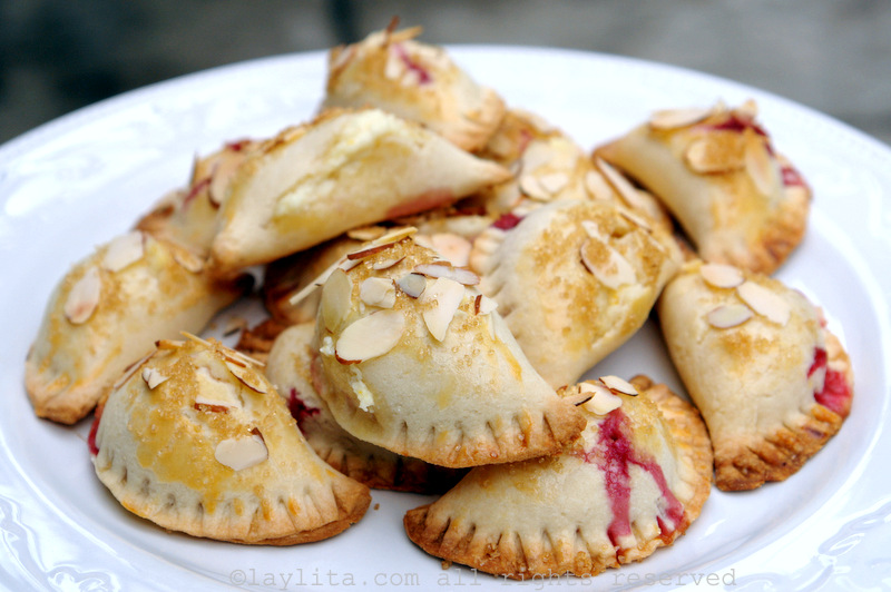 Raspberry, goat cheese and almond empanadas