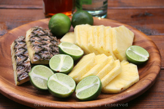 Limes and pineapple to make caipirnhas