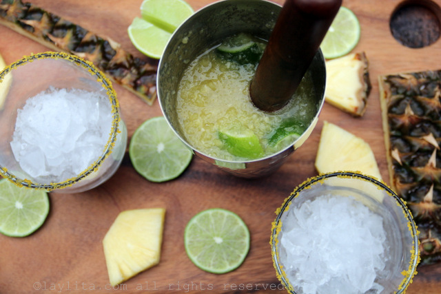 Muddle the limes with the sugar, then add the cachaca and crushed pineapple