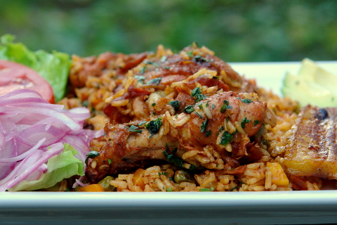 Arroz con pollo with side dishes