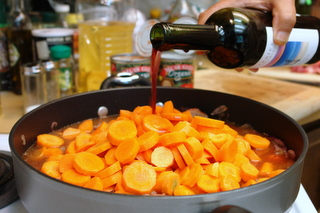 Add red wine to the daube