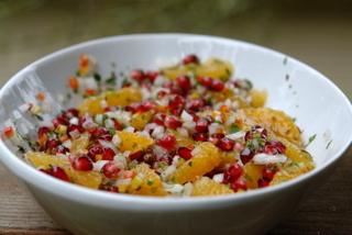 Making pomegranate and orange salsa