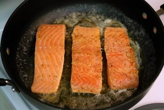 Pan sear the salmon filets in butter