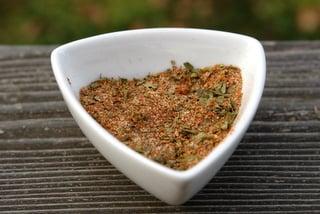 Seasoning mix with cumin, paprika, oregano, garlic, and lemon pepper
