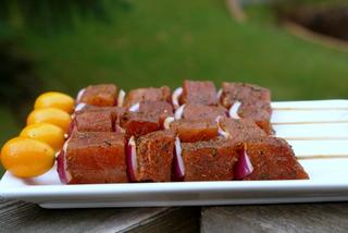 Making tuna kebabs or skewers
