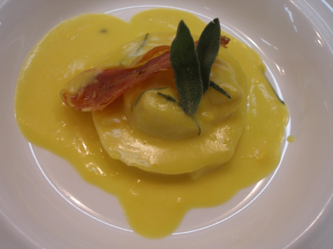 Goat cheese and sage ravioli in squash sauce