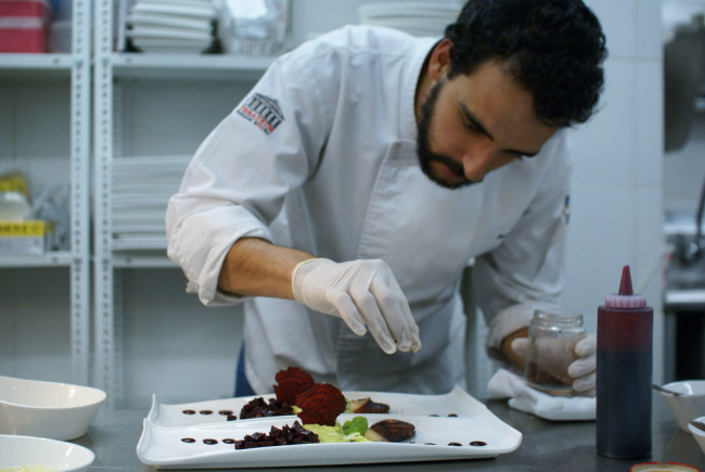 Chef Julio of Alkimia preparing an appetizer