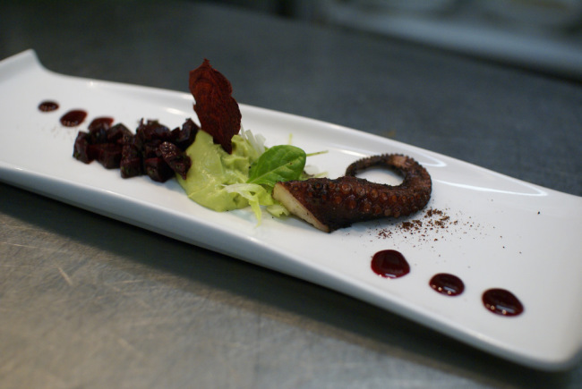 Grilled octopus with avocado mousse and beet confit
