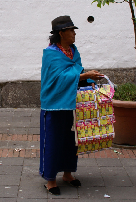 Indigenous lady selling lottery tickets