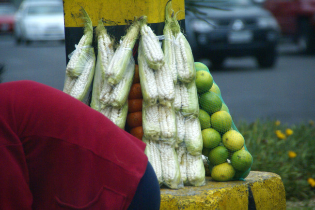 Corn and limes for sale at the traffic light