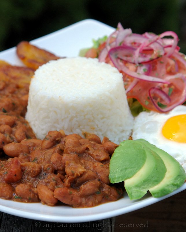 Ecuadorian bean menestra with rice, plantains, egg and salad