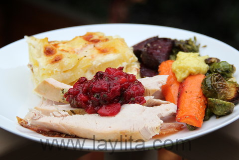 Roasted turkey with cranberry sauce, roasted vegetables and potato gratin