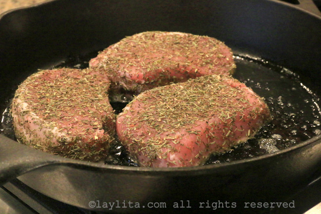 Cook the pork chops in butter
