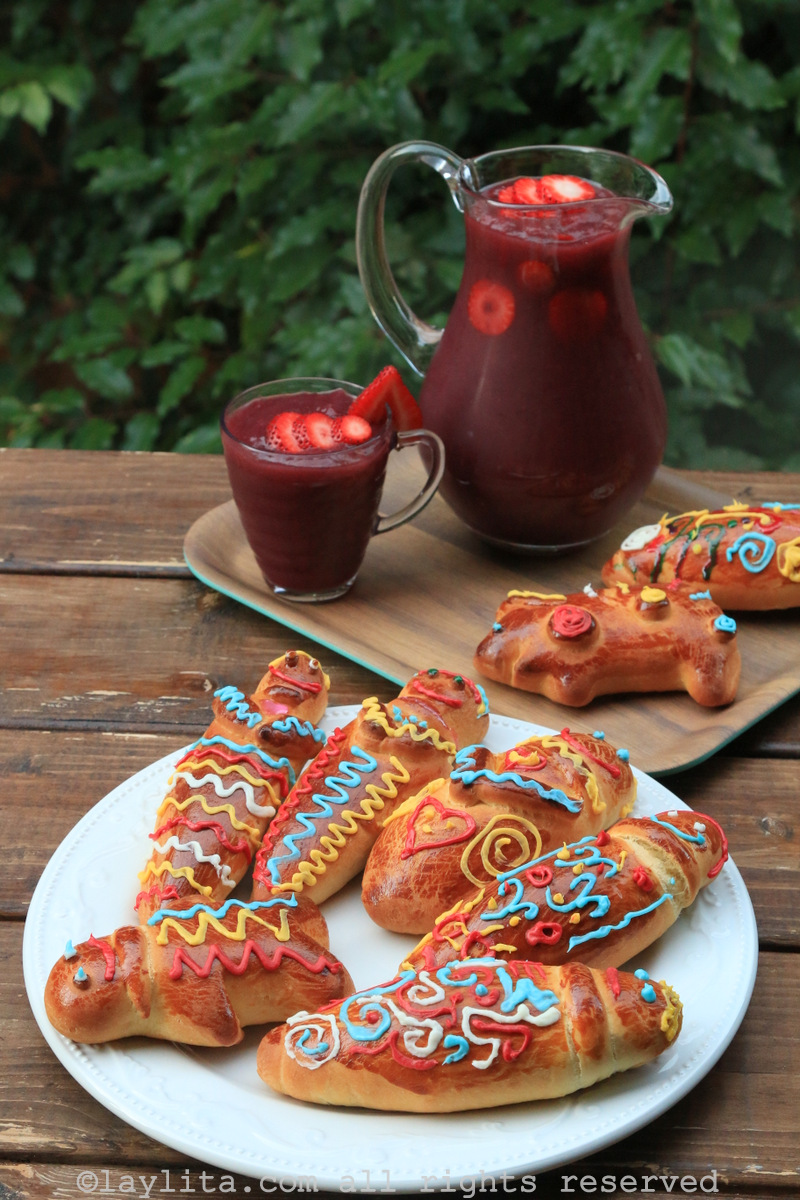 Homemade guaguas de pan and colada morada for the Día de los Difuntos or Day the Deceased in Ecuador