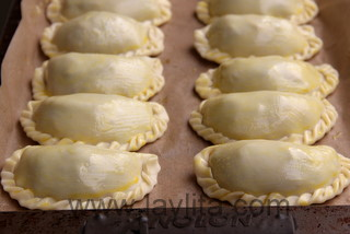 Brush the empanadas with egg wash before baking