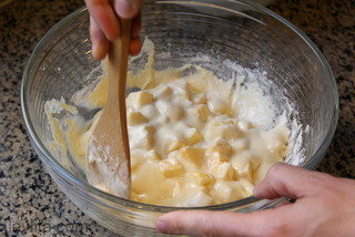 Add the apples to the cake mix