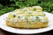 Grilled corn on the cob with queso fresco cilantro sauce