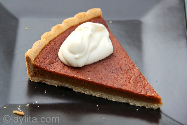 Slice of Pumpkin tart with fresh cream