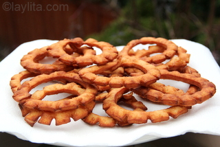 14 - Place the fried pristiños on paper towels to drain any excess oil