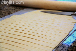 8- Use a knife to cut the dough into long strips