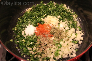 Prepare a refrito or sofrito with onions, garlic, jalapenos, cilantro and spices