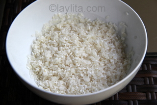 Rinse medium grain rice to cook arroz con leche or rice pudding