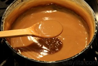 Cook until the dulce de leche is creamy and has a dark caramel color