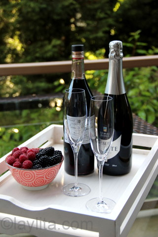 Champagne, creme de cassis and fresh berries to make a kir royal