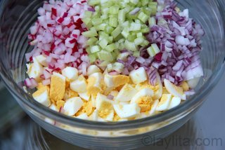 Add finely diced radishes, celery and red onions